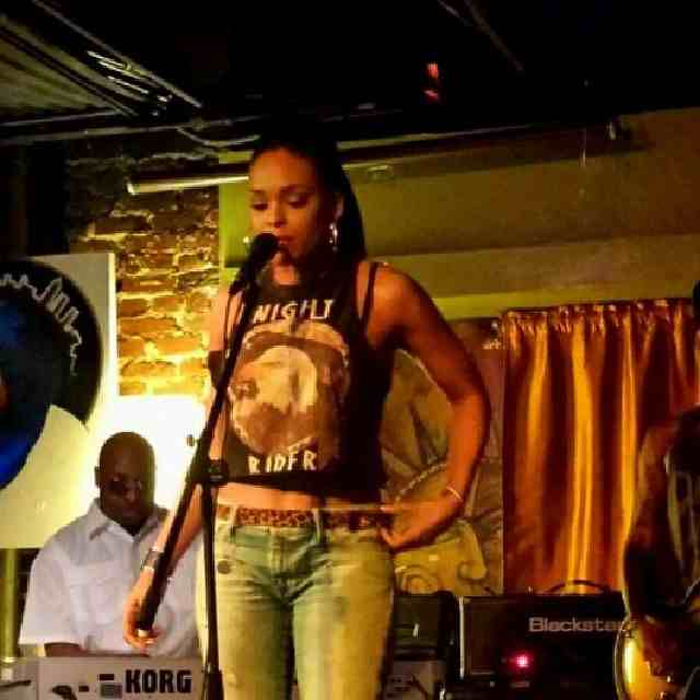 Demetria McKinney attends the $500 Poetry Slam: Rough Language at Apache Cafe